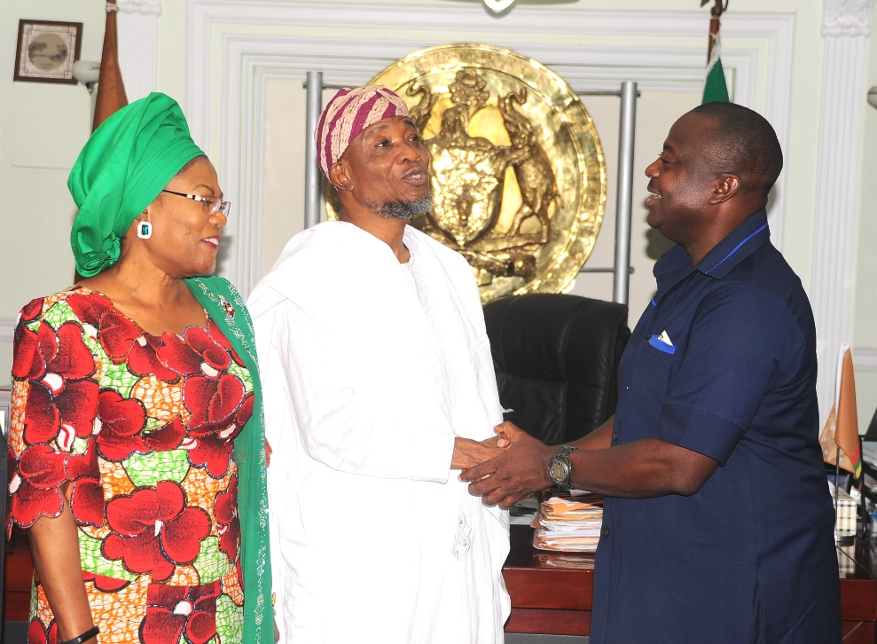 Governor State of Osun, Ogbeni Rauf Aregbesola (2nd left), exchanging pleasantries with the World Bank Representative, Dr Dele Ogunbayo (right) and Deputy Governor, Mrs Titi Loye-Tomori, during the World Bank Officials visit to the governor in his office, on thier mission to Osun on Quality of Services Assessments and Resource Tracking Students in Nigeria, at the weekend