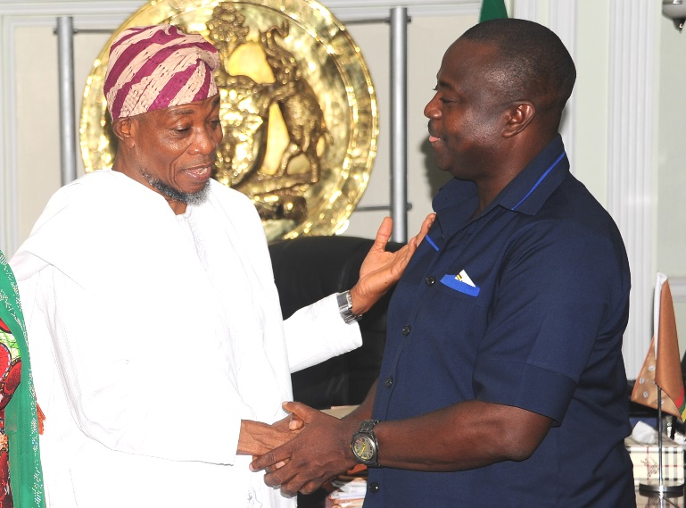 Governor State of Osun, Ogbeni Rauf Aregbesola (left) and World Bank Representative, Dr Dele Ogunbayo, during a visit to the Governor in his office by World Bank Officials on thier mission to Osun on Quality of Services Assessments and Resource Tracking Students in Nigeria, at the weekend