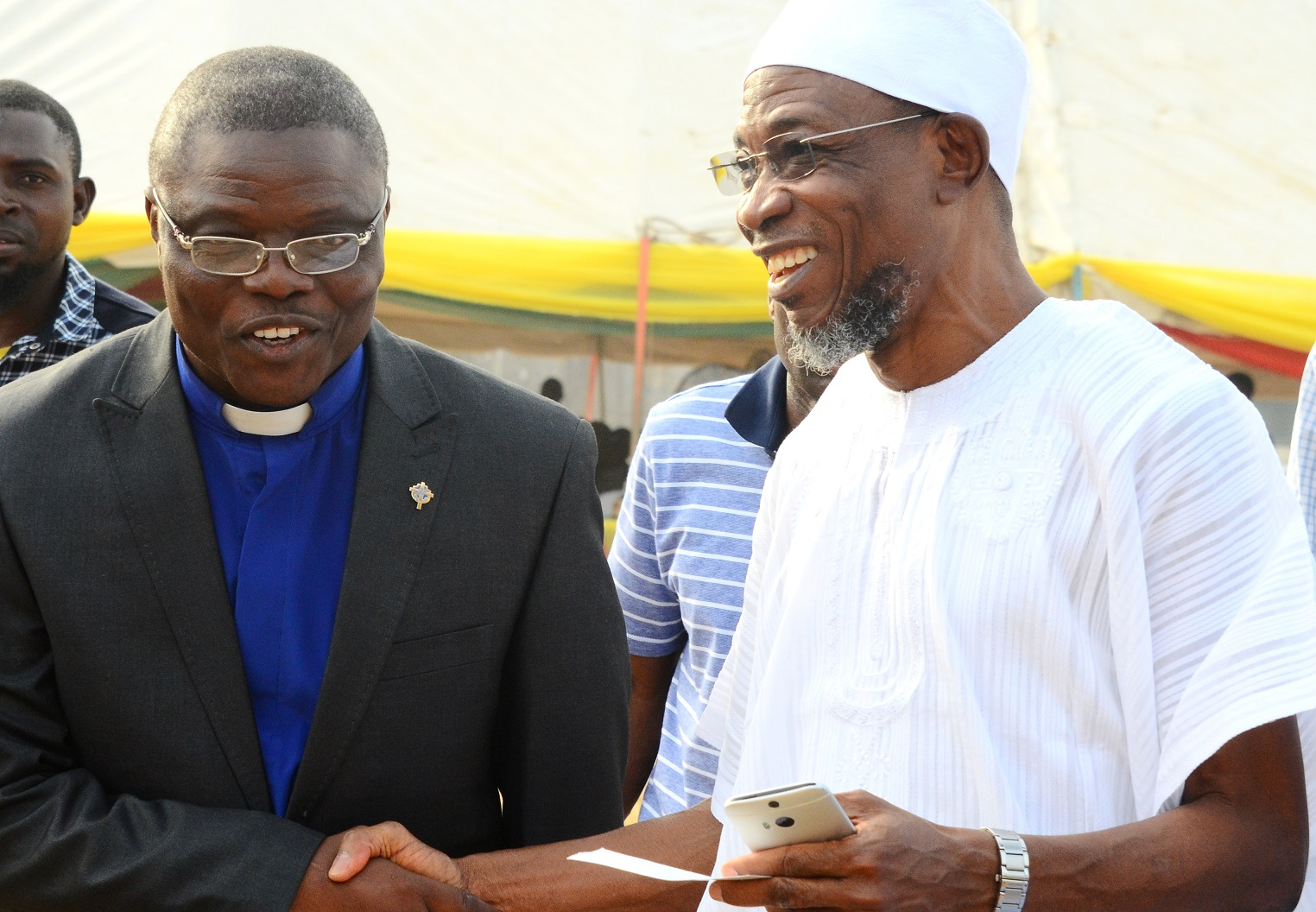 Governor State of Osun, Ogbeni Rauf Aregbesola, exchanging greetings with the State Chairman, Christian Association of Nigeria (CAN), Rev.(Dr), Elisha Ogundiya, during the 2015  Christmas Carol by the State Government of in Conjunction with State Christian Association of Nigeria (CAN), at Government House Osogbo, on Sunday 27/12/2015.