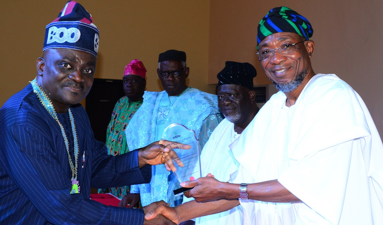 Governor State of Osun, Ogbeni Rauf Aregbesola presenting an Award of Excellence to the Chairman, House Committee on Public Procurement in the Federal House of Representatives, Hon. Oluwole Oke, National President of Ijebu-Jesa Social Club,Chief John Fademi (2nd right),Chairman Ijebu-Jesa Social Club,(Ibadan Branch),Prof. Tolu Yoloye (3rd right) and others, during the 2015 Ibadan Branch of Ijebu-Jesa Social Club Day and Award Ceremonies, at Timsed Hotel & Holiday Centre, Ijabu-Jesa on Saturday 26/12/2015.