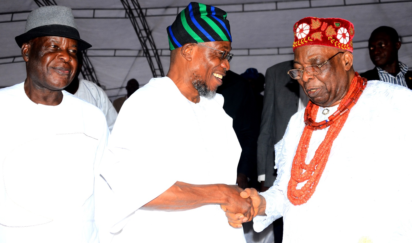 Governor State of Osun, Ogbeni Rauf Aregbesola, exchanging greetings with the  Owa Obokun Adimula of Ijesaland, Oba Gabriel Adekunle Aromolaran. With them is the former Inspector General of Police, Dr. Mike Mbama Okiro, during the 2015 Iwude Ijesa Festival at Owa's Palace on Saturday 26/12/2015.