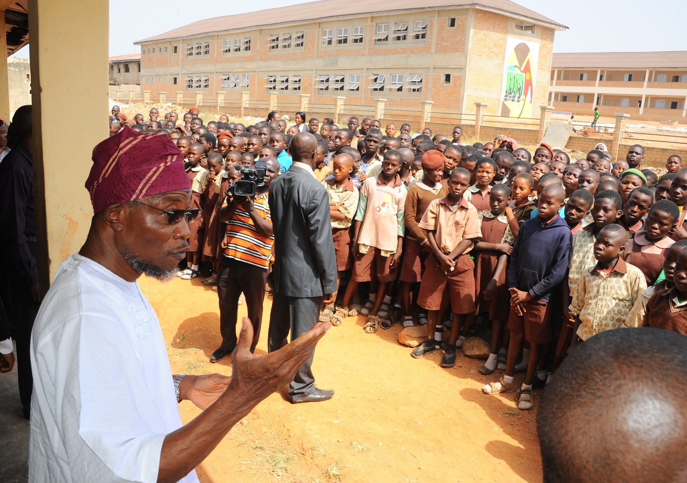 Governor State of Osun, Ogbeni Rauf Aregbesola (left), discussing with the Principal CAC Middle School 1 Araromi, Mrs Daodu Folagogun (2nd right) and Principal CAC Middle School 2 Araromi, Mrs Adetunberu Olukemi (right), during the inspection of the on going Construction of CAC Middle School Araromi Osogbo. on Wednesday 9-12-2015.