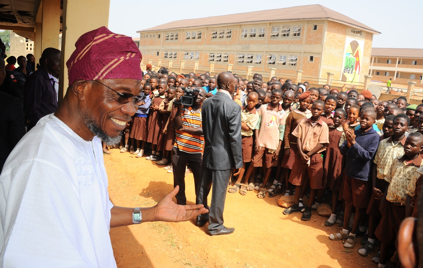 Governor State of Osun, Ogbeni Rauf Aregbesola (right); the Site Engineer, Mr Saheed Abdulrahman (2nd right). During the inspection of the on going Construction of CAC Middle School Araromi Osogbo. on Wednesday 9-12-2015.