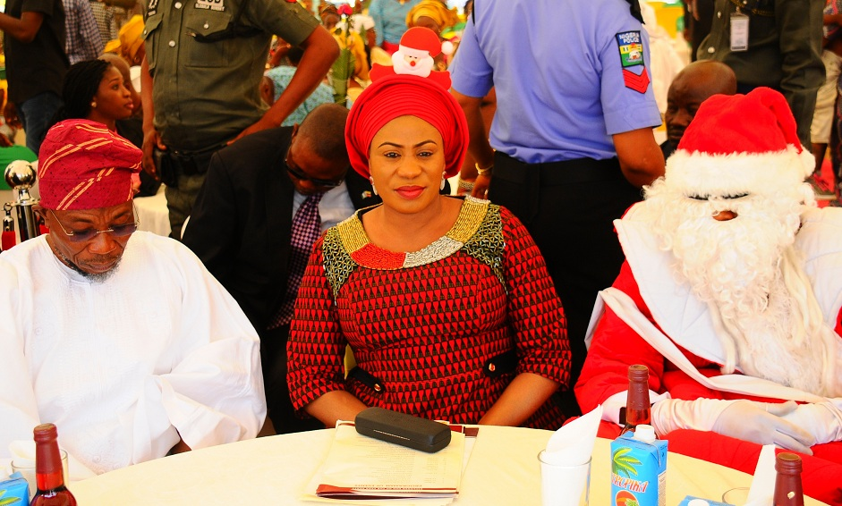 Governor State of Osun Ogbemi Rauf Aregbesola; his wife, Sherifat and father Xmass, during the distribution of gifts to children in commoration of xmass celebration, organised by wife of the governor, at the Government House Osogbo on Tuesday 22-12-2015