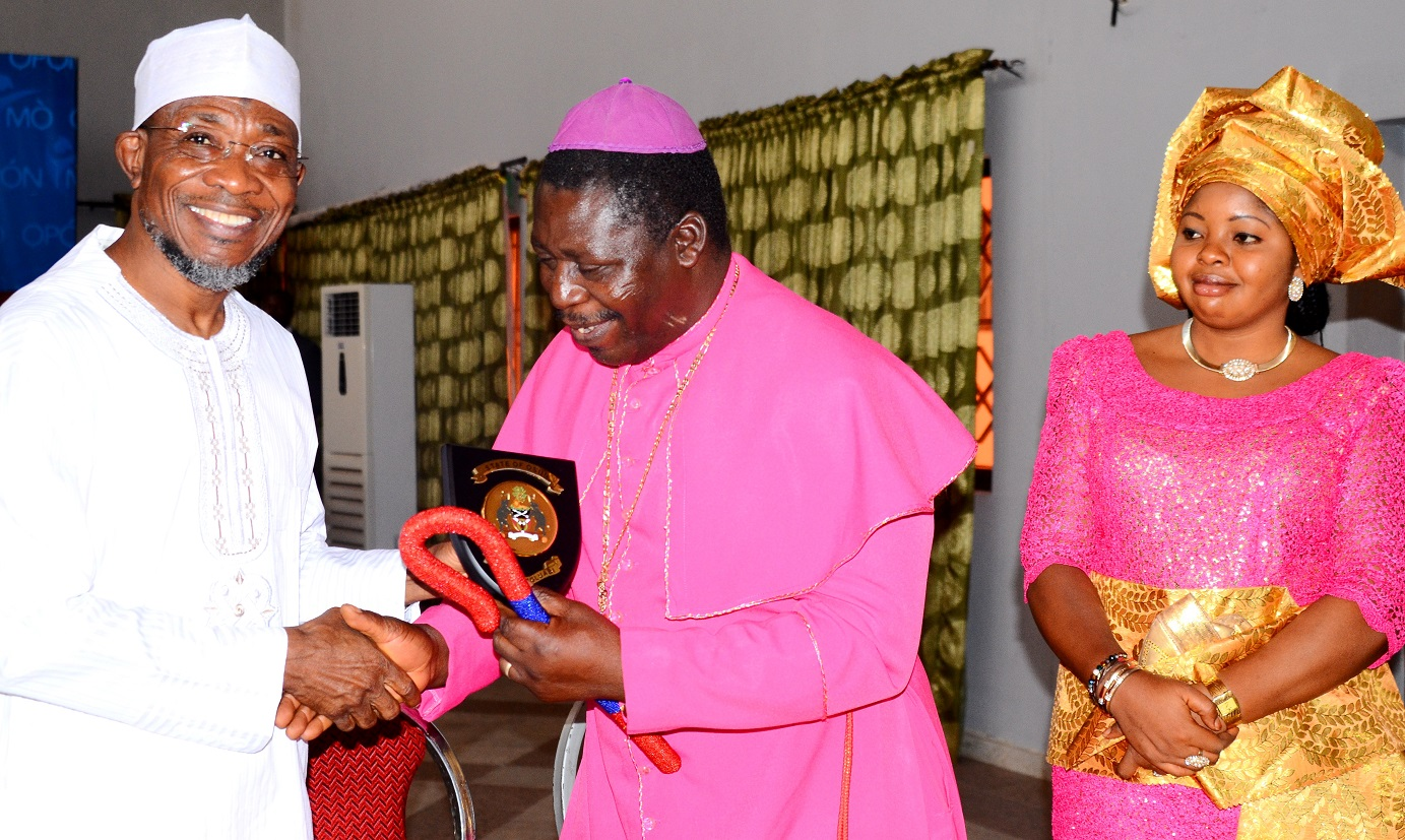 Governor State of Osun, Ogbeni Rauf Aregbesola, presenting the State Emblem to the Archbishop of Ilesa Methodist Church Nigeria, Most Rev. Amos Akindeko and his Wife, Mrs. Lola Akindeko  during a Courtesy Visit to the Governor, Osun at Government House, Osogbo