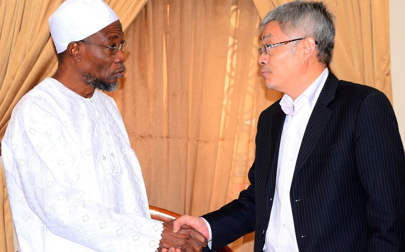 Governor State of Osun, Ogbeni Rauf Aregbesola, exchanging greetings with Chairman High Hope International Group Skyrun Corporation, Mr. Xie Shao during a visit to the Governor at his Ikeja Lagos residence on  Tuesday 29/12/2015.