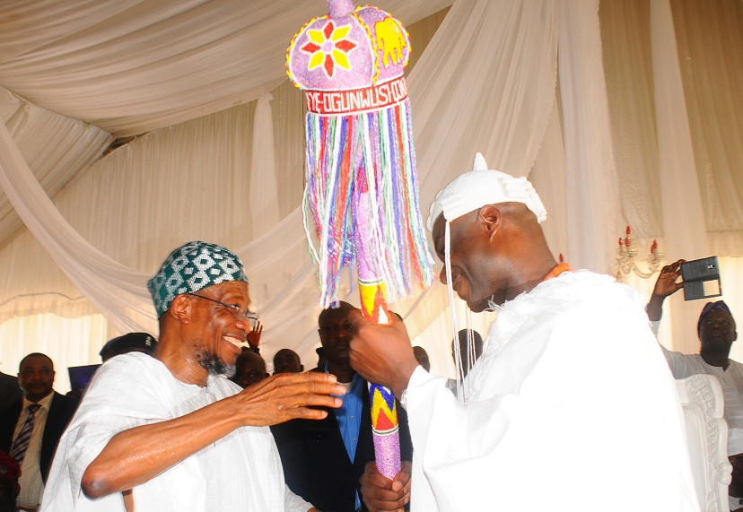 Governor of the State of Osun, Ogbeni Rauf Aregbesola presenting the Staff of Office to the New Ooni of Ile-Ife, Oba Adeyeye Enitan Ogunwusi, at the Enuwa Squre, Ile-Ife on Monday 07-12-2015