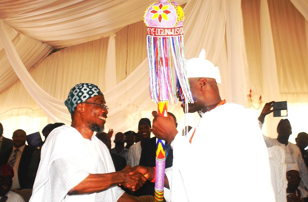 Governor of the State of Osun, Ogbeni Rauf Aregbesola presenting the Staff of Office to the New Ooni of Ile-Ife, Oba Adeyeye Enitan Ogunwusi, at the Enuwa Squre, Ile-Ife on Monday 07-12-2015