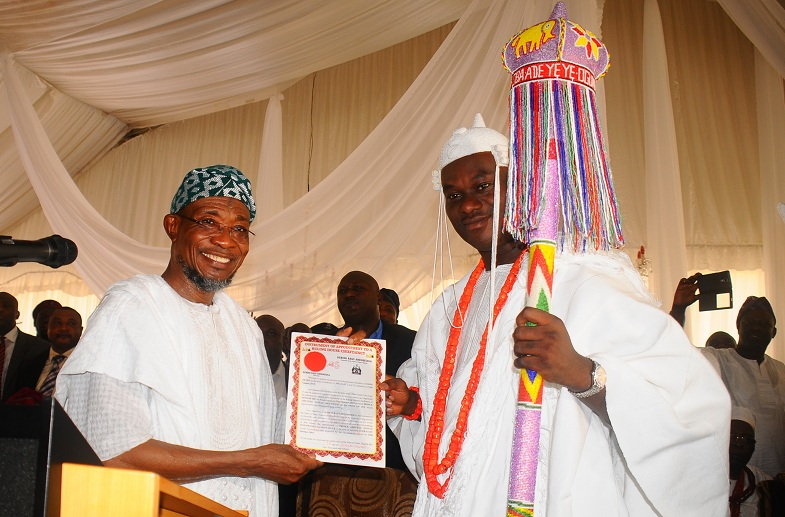 Governor of the State of Osun, Ogbeni Rauf Aregbesola presenting the certificate of Office to the New Ooni of Ile-Ife, Oba Adeyeye Enitan Ogunwusi, at the Enuwa Squre, Ile-Ife on Monday 07-12-2015