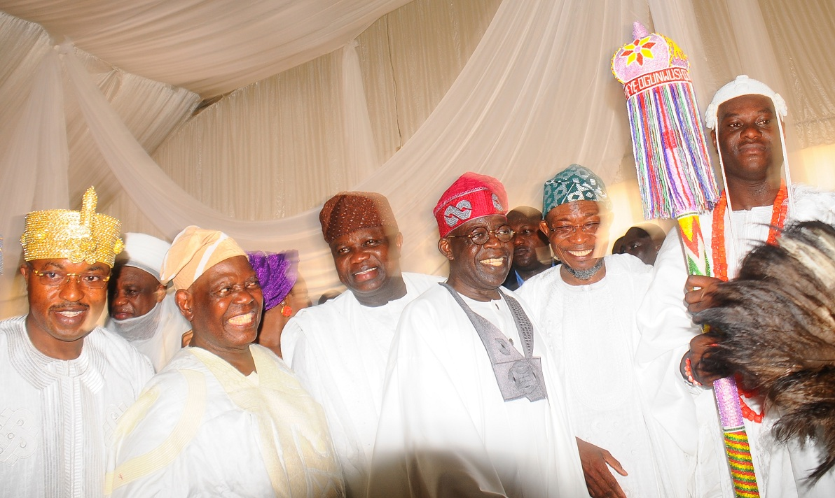 From left, The Oluwo of Iwoland, Oba Abdul Rasheed Adewale Akanbi; the Saltan of Sokoto, Alhaji Saa'd Abubakar; Chief Bisi Akande; Governor of Lagos State, Mr Akinwumi Anbode; Senator Ahmed Bola Tinubu; Governor of Osun, Ogbeni Rauf Aregbesola and the newly installed Ooni of Ile-Ife, Oba Adeyeye Enitan Ogunwusi, during the installation of the Ooni of Ile-Ife., at Enuwa Squre, Ile-Ife on Monday 07-12-2015