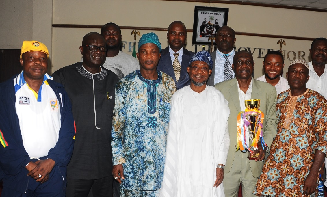 Governor State of Osun Ogbeni Rauf Aregbesola (3rd right); Secretary to the State Government, Alhaji Moshood Adeoti (3rd left); Chairman Osun Football Assosiation, Mr Taiwo Ogunjobi (2nd right); Former Special Advisers on Youth Sport and Special Need, Comrade Biyi Odunlade (left); Special Adviser to the governor on Security Matters, Tope Adejumo (2rd left); Vice Chairman Osun Football Assosiation, Engr Jimoh Olayemi (right), during the courtesy visit and Presentation of Under 13th Gold Medal, Trophy to the governor by Osun Under 13th Youth that won the Maiden South West Football Tournament recently in Akure, at the Governor Office Secretariat Abere at the weekend