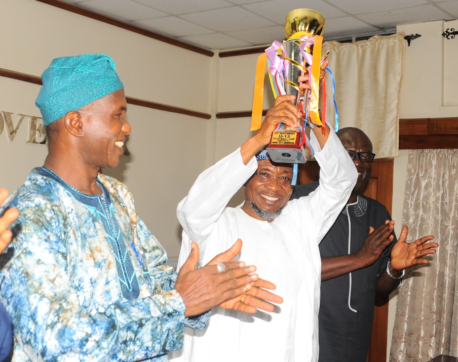 Governor State of Osun Ogbeni Rauf Aregbesola (2nd right); Secretary to the State Government, Alhaji Moshood Adeoti (left); Special Adviser to the governor on Security Matters, Tope Adejumo (right); Vice Chairman Osun Football Assosiation, Engr Jimoh Olayemi (right), during the courtesy visit and Presentation of the Under 13th Gold Medal, Trophy to the governor by Osun Under 13th Youth that won the Maiden South West Football Tournament recently in Akure, at the Governor Office Secretariat Abere, at the weekend