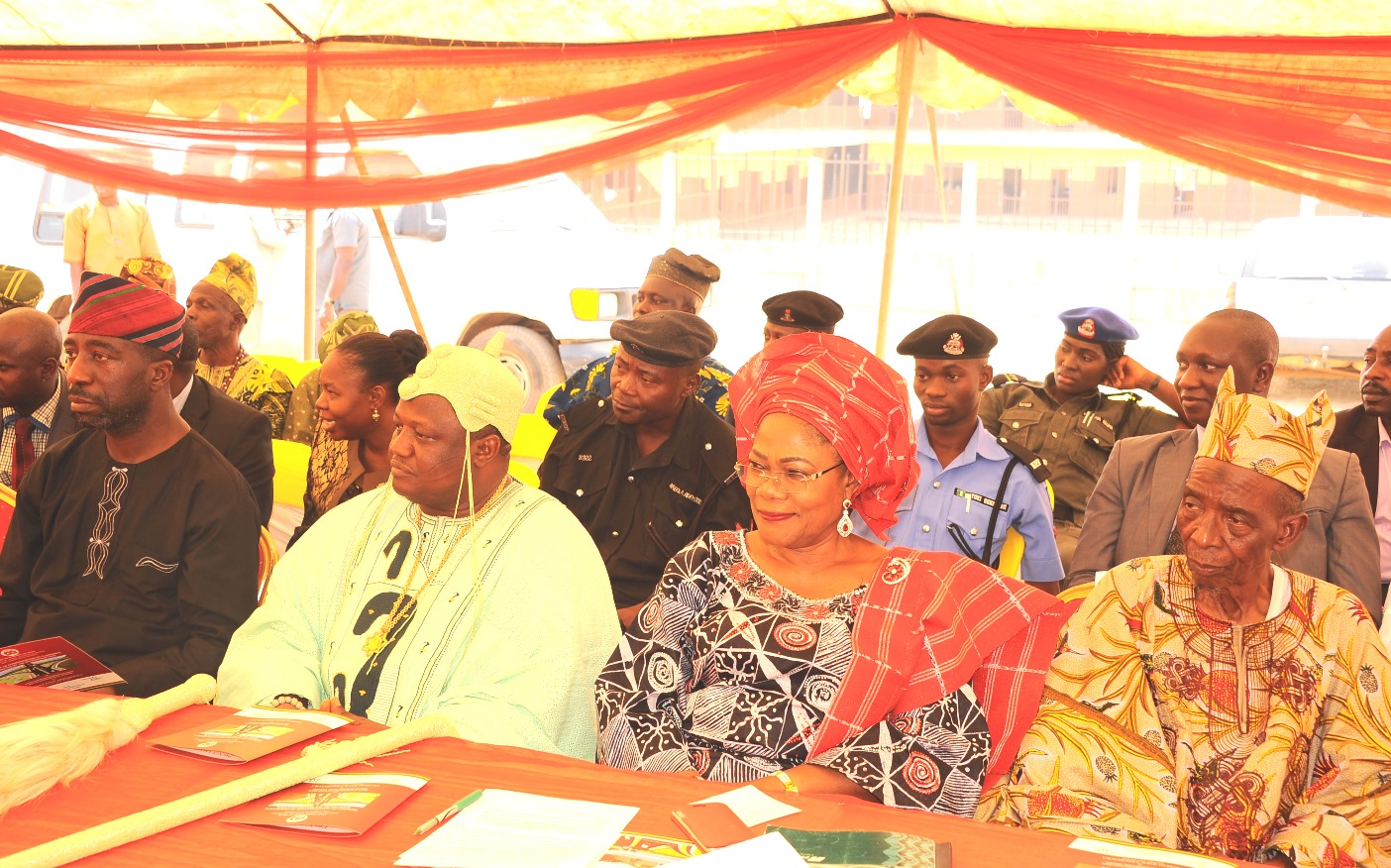 Governor State of Osun, Ogbeni Rauf Aregbesola, represented by his Deputy, Mrs Titi Laoye-Tomori (2nd right); Former Commissioner for Lands, Physical Planning and Urban Development, Architect Muyiwa Ige (left); the Ataoja of Osogbo, Oba Jimoh Olanipekun (2nd left) and wife of the Baale of Isale-Osun, Chief Saliu Moniade, during the Payment of Compensation to the people affected by the reconstruction of Orita Olaiya, Asubiaro, Isale-Osun and Ita Olookan Road, Osogbo, at Laro-Timehin Middle School Isale Osun on Wednesday 16-12-2015