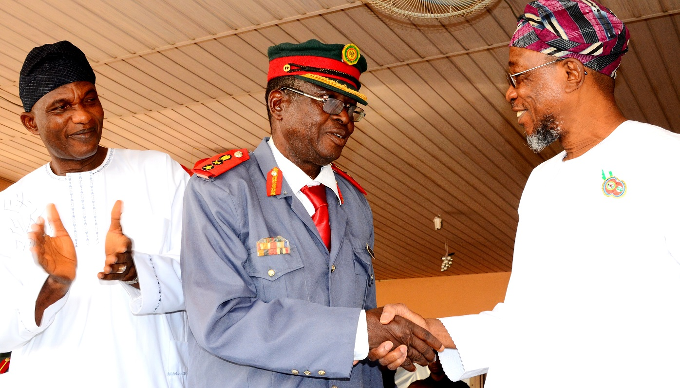 Governor State of Osun, Ogbeni Rauf Aregbesola, greeting the Chairman, Nigeria Legion State of Osun, Col. Alimi Samotu and Secretary to the State Government, Alhaji Moshood Adeoti during the Launching of 2016 Emblem of the Armed Forces Remembrance Day Celebrations at Government house Osogbo, On Thursday 07/01/ 2016.