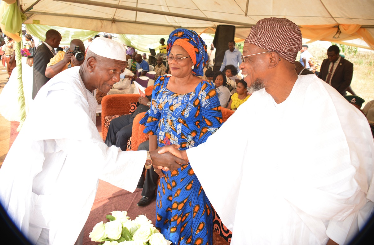 Governor State of Osun, Ogbeni Rauf Aregbesola (right); congratulating one of the Chairmen of the newly inaugurated Community Based School Management Committee, High Chief Christopher Ayodele. With them is the deputy governor, Mrs Titi Laoye-Tomori, after the inauguration at the Government Technical College, Osogbo on Thursday 14-01-2016