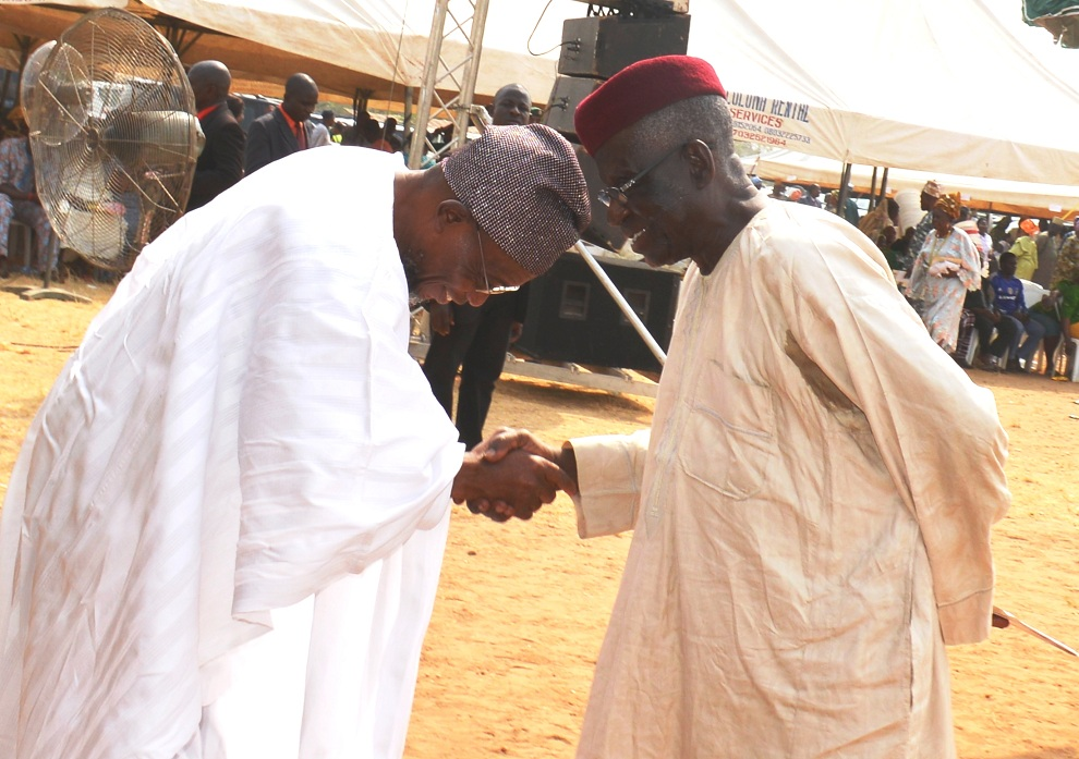 Governor State of Odun, Ogbeni Rauf Aregbesola (right), congratulating one of the newly inaugurated Chairmen of the Community Based School Management Committee, Chief Samuel Oladepo Omoeumi, after the inauguration at the Government Technical College, Osogbo on Thursday 15-01-2016