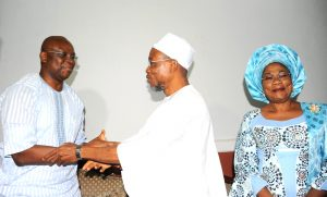 Governor State of Osun, Ogbeni Rauf Aregbesola (2nd right); welcoming  the EKITI State Governor, Dr Ayodele Fayose (left)