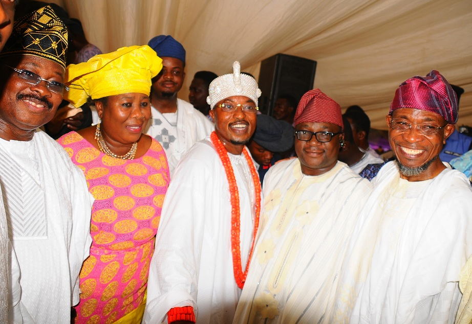 Governor Isiaka Abiloa Ajimobi of Oyo (left); his Osun counterpart, Ogbeni Rauf Aregbesola (right); Chief Judge of Osun, Justice Adepele Ojo (2nd left); the Oluwo of Iwoland, Oba, Abdul Rasheed Adewale Akanbi and others, during the presentation of staff of office to Oluwo by Governor Aregbesola, at the Reality Television Station Premises in Iwo on Saturday 16-01-2016