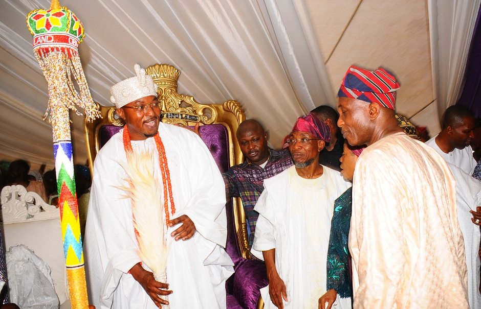 From left, Oluwo of iwoland, Obama Abdul Rasheed Adewale Akanbi; Governor of the State of Osun Igbeni Rauf Aregbesola and Secretary to Osun Government and Chairman planning committee of Oluwo coronation, Alhaji Moshood Adeoti, during the presentation of staff of office to Oluwo by Governor Aregbesola, at the Reality Television Station Premises in Iwo on Saturday 16-01-2016