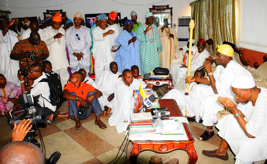 Governor State of Osun, Ogbeni Rauf Argbesola (right), receiving blessings from a cross sections of Chiefs of Ife (left) by the order of the Ooni of Ife, Oba Adeyeye Enitan Ogunwusi (2nd right), during a visit to the Governor at the Government House, Osogbo on Wednesday 06-01-2016