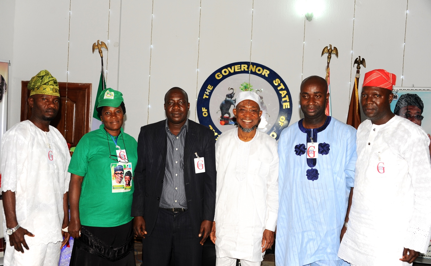 Governor State of Osun, Ogbeni Rauf Aregbesola (3rd right); National Youth Leader, Coalition of APC Supporters Group Abuja, Comrade Mojeed Yaya (3rd left); Deputy National Chairman South Coalition of the group, Barrister Kunle Ehinlanwo (2nd right); State Co-Ordinator, Hon Shekete Adamson (right); State Welfare Officer, Alhaja Abass Fatima (2nd left) and a member of the Group Prince Ayatuga Alaba, during the Presentation of Educational Materials to thr Governor in Appreciation and Support of Government Educational Policy by Coalition of APC Supporters Group Abuja, at The Government House Osogbo. On Thursday 31-12-2015.