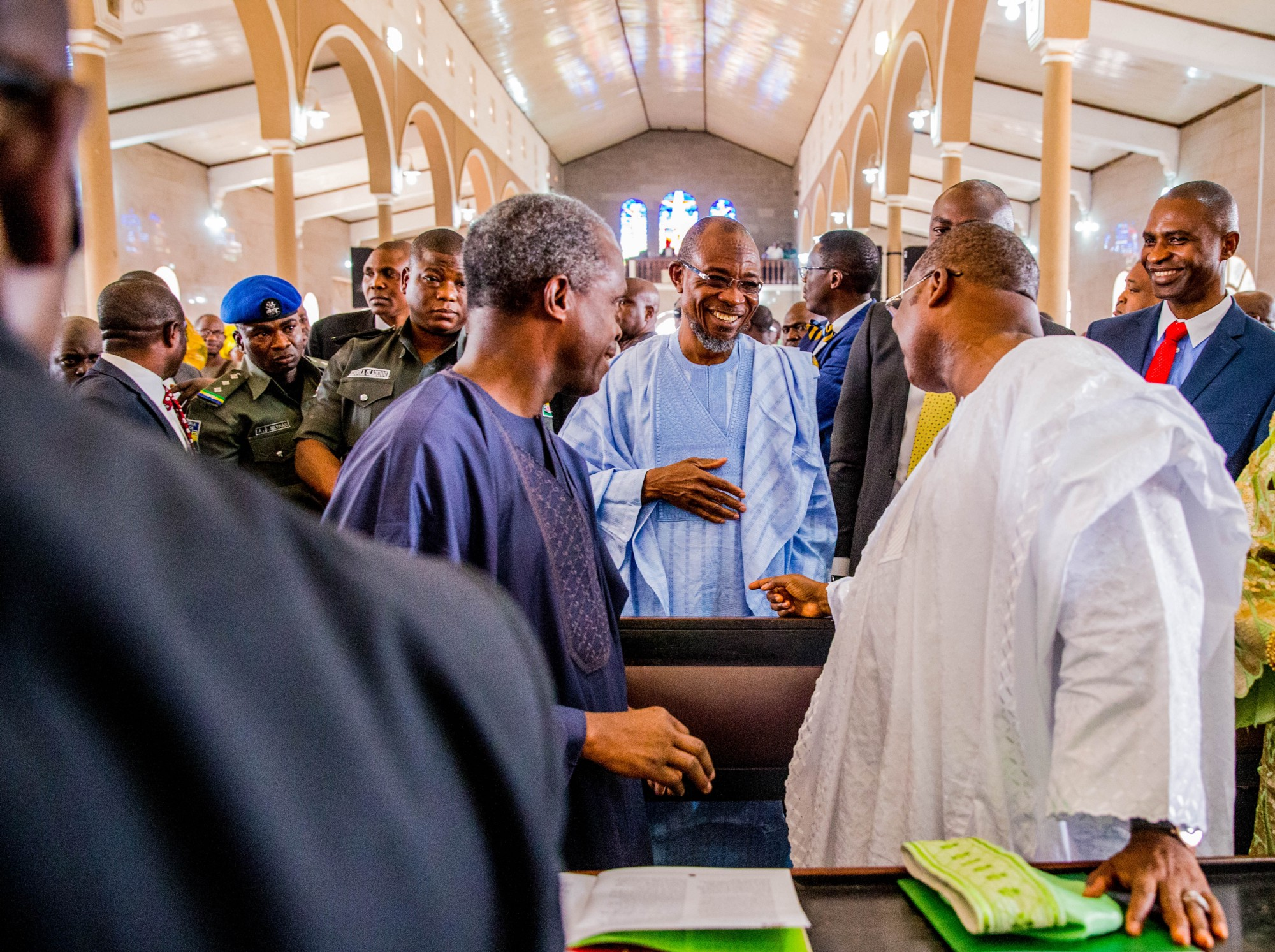 Vice- President Prof. Yemi Osinbajo and Governor Ajimobi greet Governor of The State of Osun Ogbeni Rauf Aregbesola during the funeral service for the Olubadan of Ibadanland at the Cathedral of St Peter, Aremo, Ibadan. (Photo by: Tolani Alli)