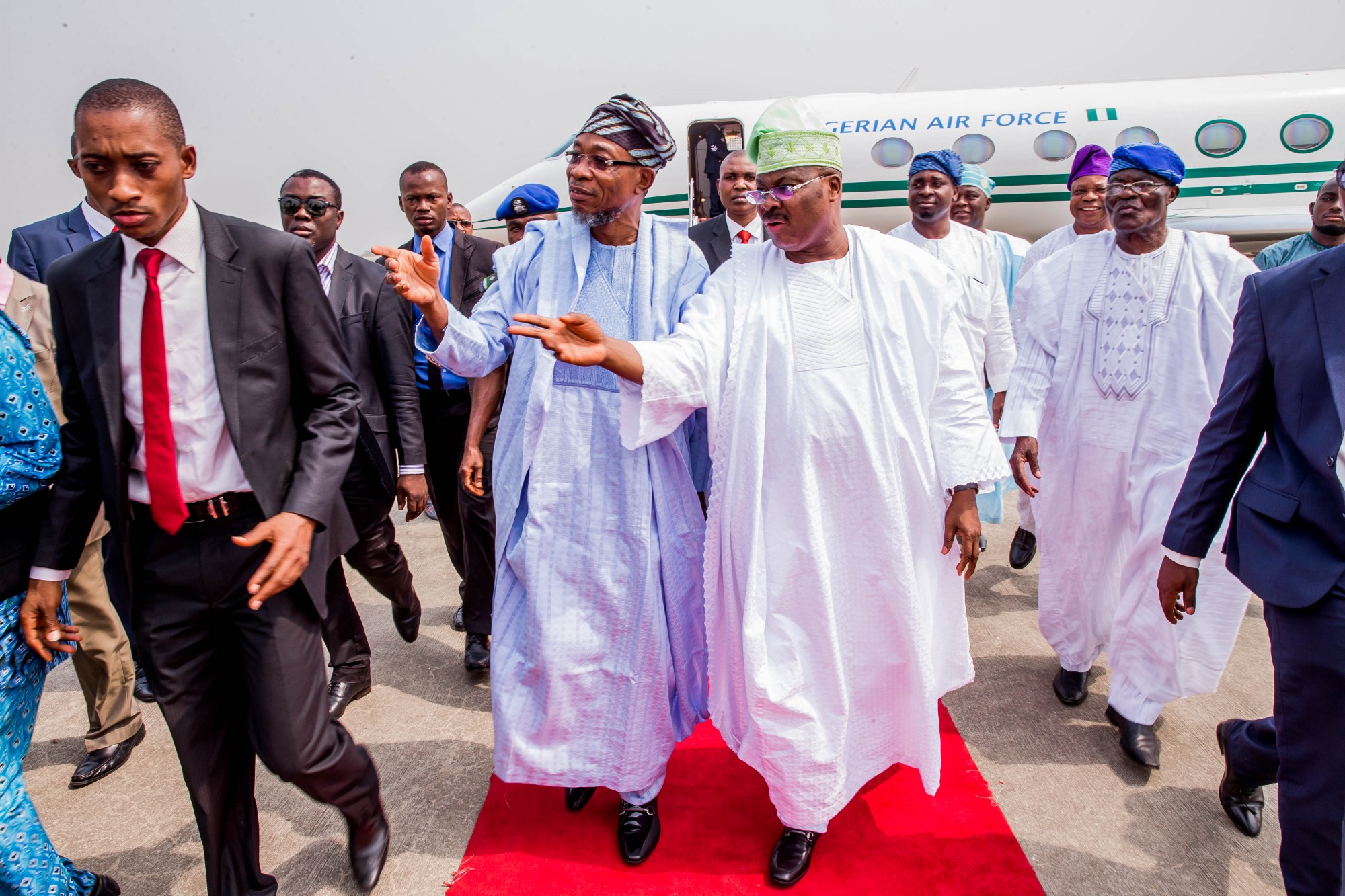 Governor Ajimobi and Governor Aregbesola discuss as they walk back after seeing off Vice- President Prof. Yemi Osinbajo to his plane. (Photo by: Tolani Alli)