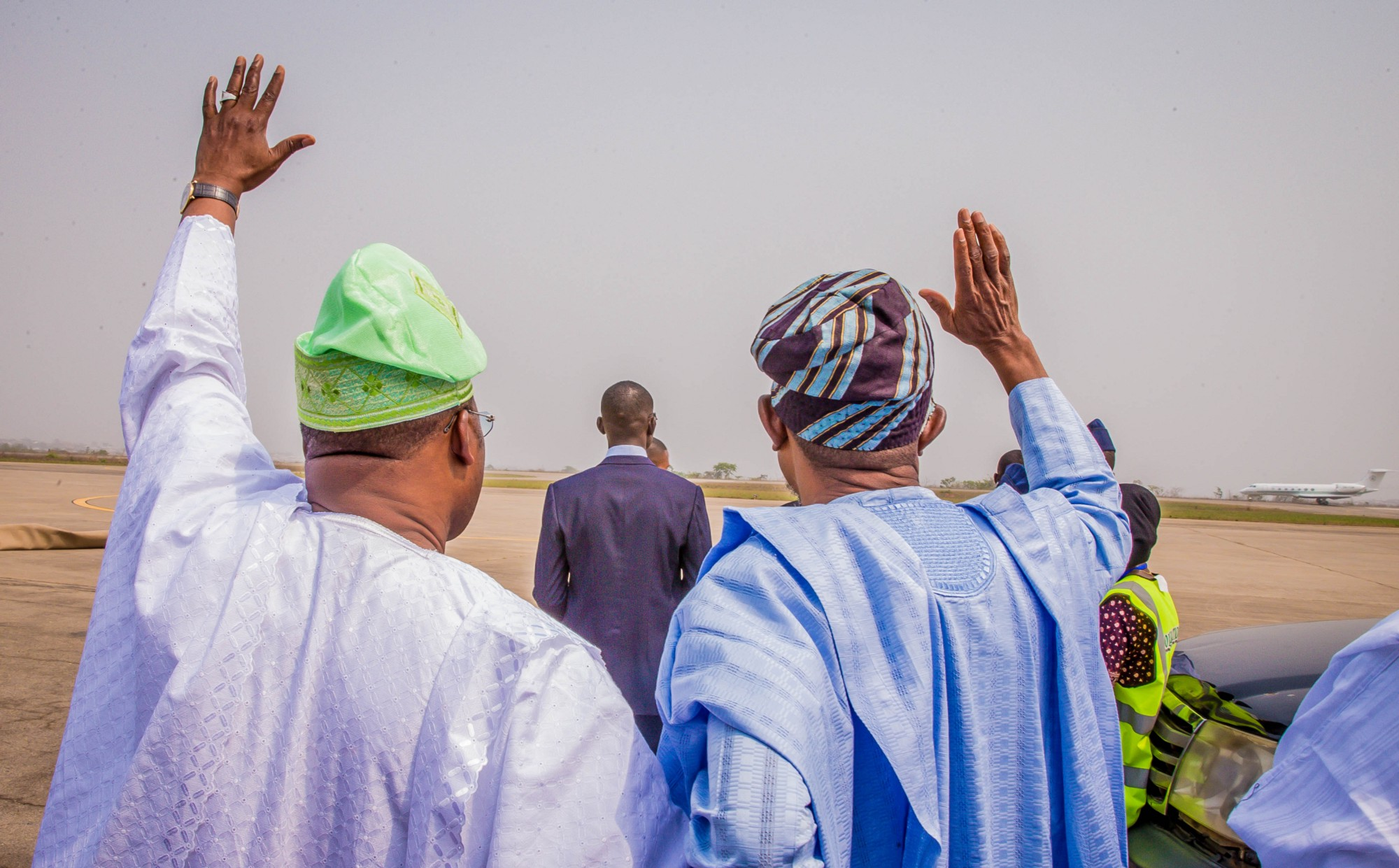Governor Ajimobi and Governor Aregbesola wave good-bye as Vice- President Yemi Osinbajo's plane takes off from Ibadan. (Photo by: Tolani Alli)