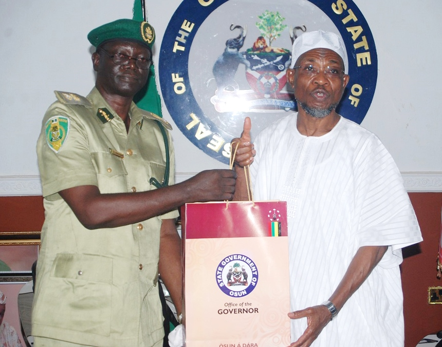 Governor State of Osun, Ogbeni Rauf Aregbesola presenting the State Emblem to the New Comptroller of Prisons, Osun State Command, Mr. Segun Oluwasemire during a Courtesy Visit to the Governor, at Government House Osogbo, on Thursday 4/2/2016