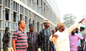Governor State of Osun, Ogbeni Rauf Aregbesola (right),Site Engineer, Sami Angel (left), Secretary to the State Government,Alhaji Moshood Adeoti (2nd right), and Head of Service, Mr. Sunday Owoeye (2nd left),  during the unscheduled inspection to the ongoing construction of Ilesa Government High School, Ilesa, on Sunday 31-01-2016.