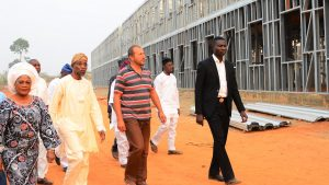 Governor State of Osun, Ogbeni Rauf Aregbesola (middle), his Deputy, Mrs. Titi Laoye-Tomori (left), and  Site Engineer, Sami Angel (right), during the unscheduled inspection to the ongoing construction of Ilesa Government High School, Ilesa, on Sunday 31-01-2016.