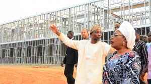 Governor State of Osun, Ogbeni Rauf Aregbesola (middle), and his Deputy, Mrs. Titi Laoye-Tomori (left), during the unscheduled inspection to the ongoing construction of Ilesa Government High School, Ilesa, on Sunday 31-01-2016.