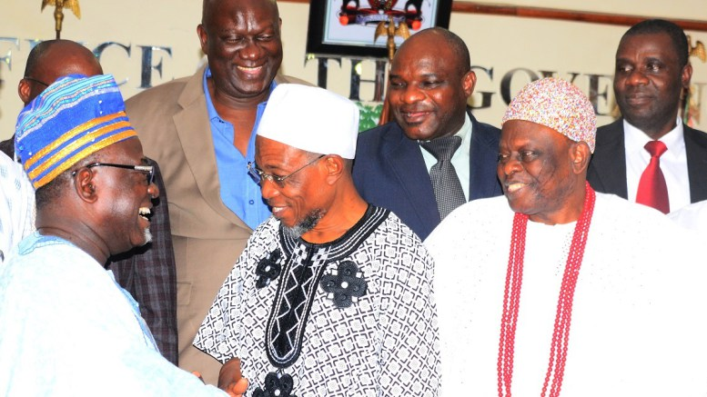 Governor-Aregbesola-exchanging-pleasantries-with-the-Chairman-of-LAUTECH-Governing-Board-Professor-Oluwole-Atoyebi-while-Aragberi-of-Iragberi-Oba-Folorunso-Agboade-Makanju-and-others-watch