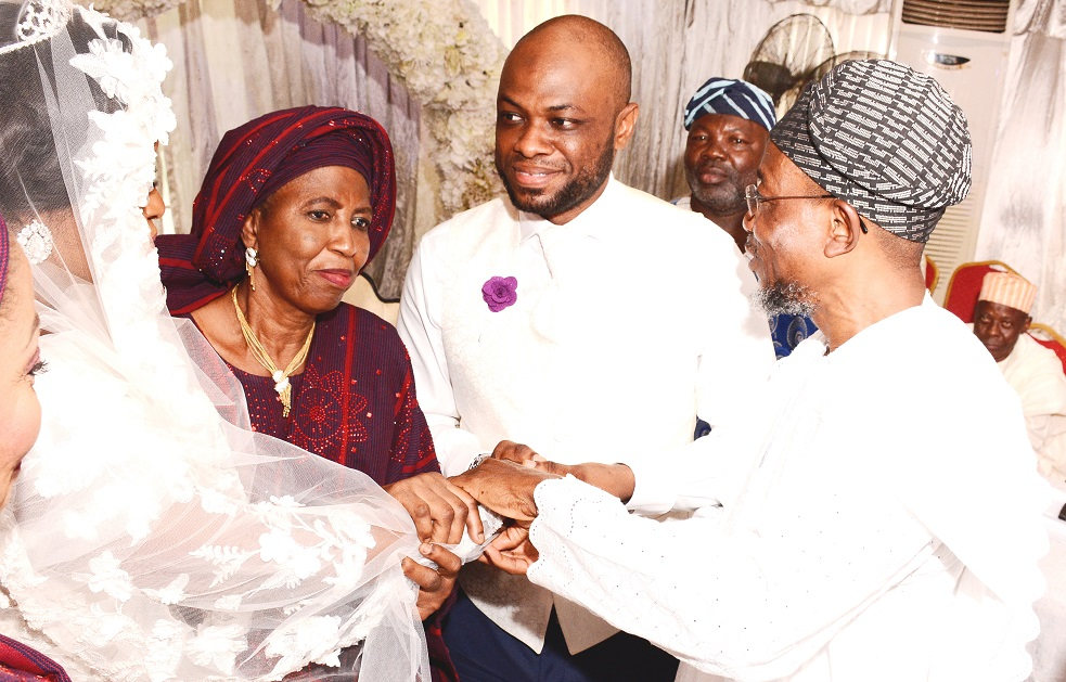 Governor State of Osun, Ogbeni Rauf Aregbesola representing Groom's father; Groom's mother, Alhaja Titilayo Abolude, Bride's mother, Alhaja Rashidat Ajose and the newly wedded couple, Shakirat Oluwabukola Ajose and Mutahir Abolude, during the Nikkah ceremony between Ajose and Abolude's families, at Grandeur Event Centre, Oregun, Ikeja, Lagos