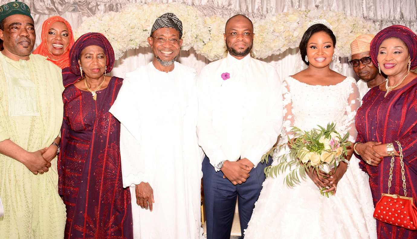 Governor State of Osun, Ogbeni Rauf Aregbesola representing Groom's father (middle); Groom's mother, Alhaja Titilayo Abolude (3rd left), Bride's mother, Alhaja Rashidat Ajose (right), Senator Ganiyu Olanrewaju Solomon (left) and the newly wedded couple, Shakirat Oluwabukola Ajose and Mutahir Abolude, during the Nikkah ceremony between Ajose and Abolude's families, at Grandeur Event Centre, Oregun, Ikeja