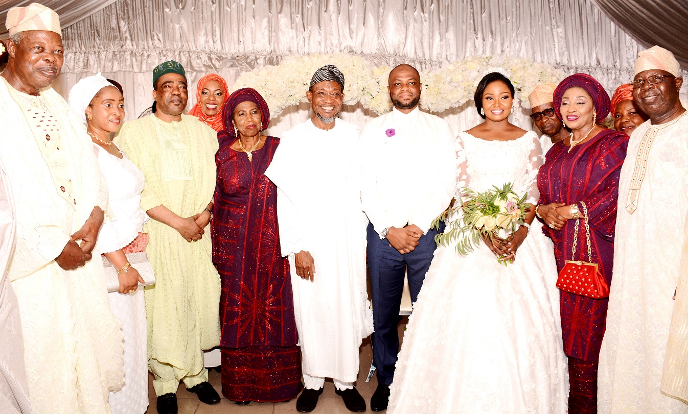 Governor State of Osun, Ogbeni Rauf Aregbesola representing Groom's father (5th right); Groom's mother, Alhaja Titilayo Abolude (5th left), Bride's mother, Alhaja Rashidat Ajose (2nd right), Senator Ganiyu Olanrewaju Solomon (3rd left),  the newly wedded couple, Shakirat Oluwabukola Ajose and Mutahir Abolude and others, during the Nikkah ceremony between Ajose and Abolude's families, at Grandeur Event Centre, Oregun, Ikeja, Lagos,